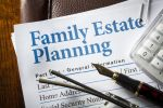 Estate Planning with pen, glasses, and caculator
